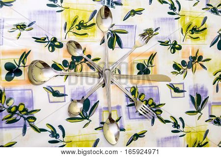 Spoon fork and knife on tablecloth close up