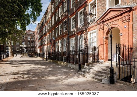 LONDON, UK - AUGUST 8 2006: A view along Kings Bench Walk a street in the Temple district of London known as the legal district with barristers chambers in traditional old London town houses.