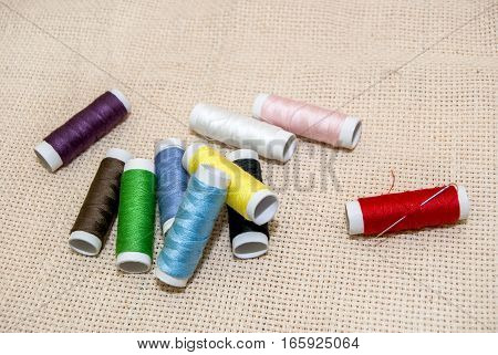 set of Sewing multicolored threads as background.