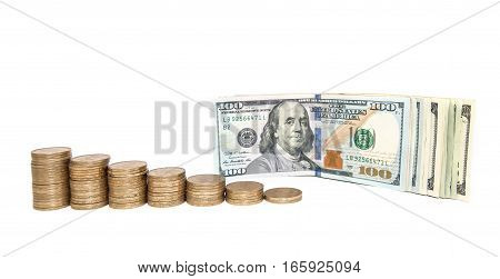 Lot of golden coins in rising price graph or bar chart with US currency one hundred dollar bills