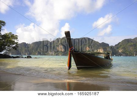 beautiful marine landscape view of long tail boat on the beach at koh phi phi island in Thailand in Krabi province South Asia in holiday and vacation travel and tourist destination concept