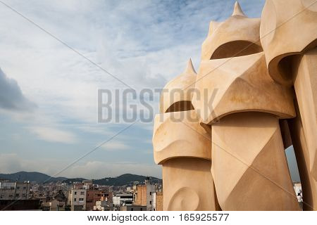 BARCELONA, SPAIN - SEPTEMBER 28 2006: Abstract detail of sculptural detail from chimney pots on a Gaudi building Barcelona Spain.