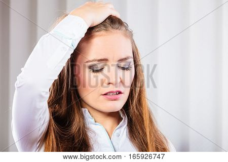 Emotionsstressful situation in work trouble and anxiety. Young woman in white shirt pull hair.