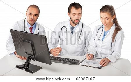 Portrait of Doctors Looking at Computer Monitor and Writing on Clipboard