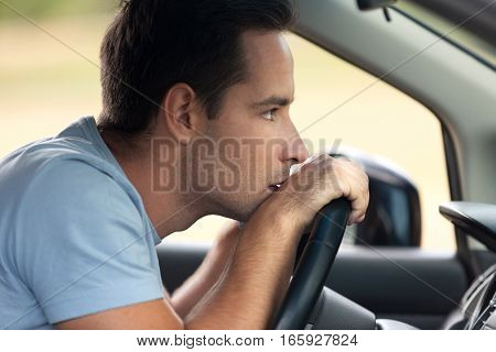 Portrait of a Man Thinking in his Car