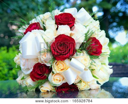 beautiful wedding bouquet made of different color roses