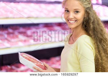Portrait of a Woman Buying Meat in a Supermarket