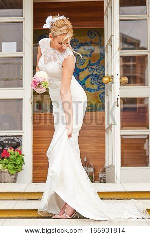 Beautiful Bride on Staircase with Dress Hiked Up.