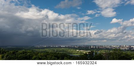 landscape with the approaching cumulonimbus clouds over the city