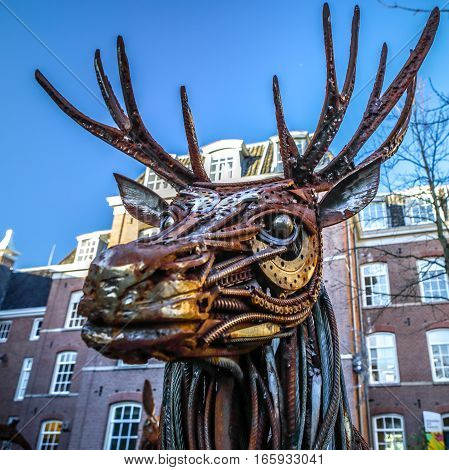 AMSTERDAM NETHERLANDS - JANUARY 08 2017: Dear from rusted metal elements. Famous sculptures of Amsterdam city centre. January 08 2017 in Amsterdam - Netherlands.