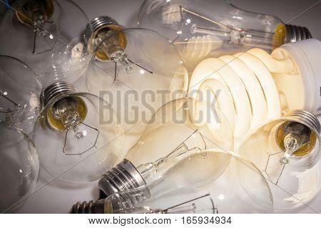 One Lit Light Bulb with Unlit Light Bulbs