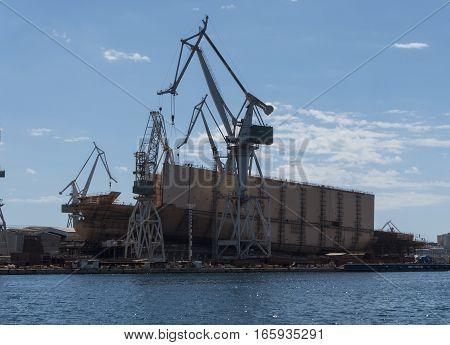 Shipyard building a ship on a sunny day