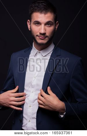Handsome Young Man Buttoning Jacket Suit
