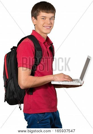 Teen male preppy with a school backpack carrying a laptop