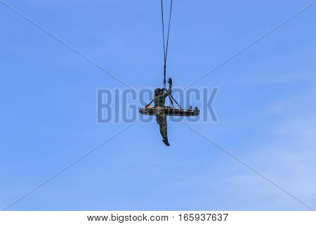 Soldier rescue emergency by army helicopter with rope on blue sky