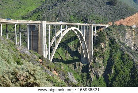 BIG SUR CA 04 14 15: Bixby Creek Bridge or Bixby Bridge on the Big Sur coast of California, is one of the most photographed bridges in California due graceful architecture and magnificent setting.