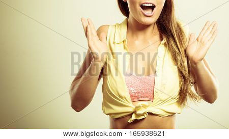 Shock suprise emotions. Suprised and shocked pin up woman. Young lady wearing yellow shirt and pink bra.
