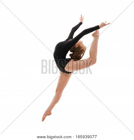 Young blonde girl in black sportsuit smartly jumping studio shot