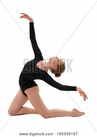 Young blonde girl in black sportsuit in graceful pose studio shot