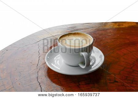 coffee cappuccino in wood floor close up on white background