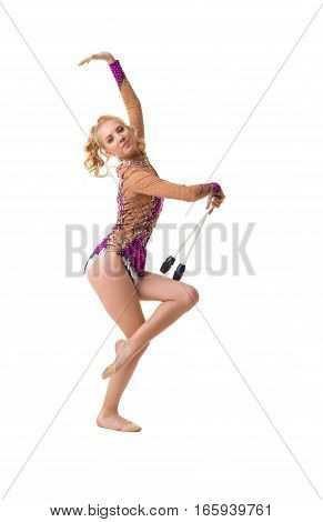 Young blonde girl in artistic embroidered violet sportsuit exercising with a mace studio shot