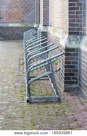 Big iron bike rack besides the church