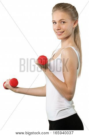 Young, fit woman in a tanktop doing dumbbell curls