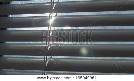 The sun nice shining through the blinds
