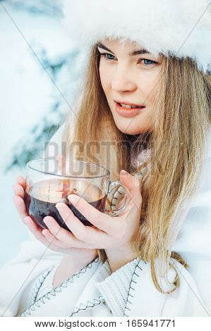 beautiful girl with a cup of coffee in the winter