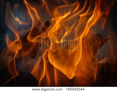 burning fire in a brick fireplace close up close up