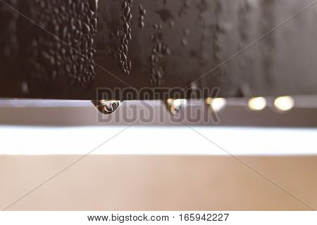 Closeup image of condensation water drops on a window frame.