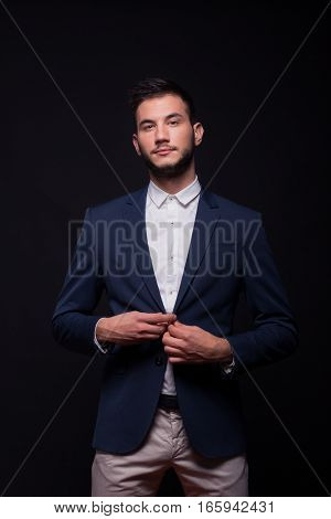 Young Man Model Buttoning Jacket Suit Elegant