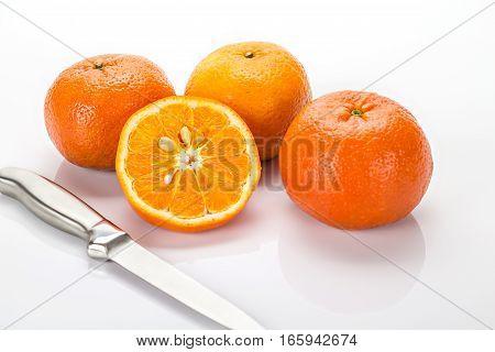 Fresh Orange And Knife Isolated On White Background