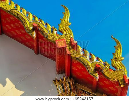 Detail of the ancient Wat Pho Temple's roof. Bangkok, Thailand