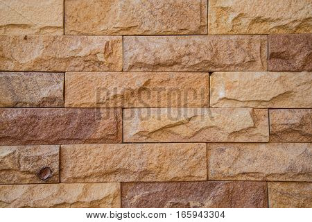 The stone cut like the brick wall textured background.