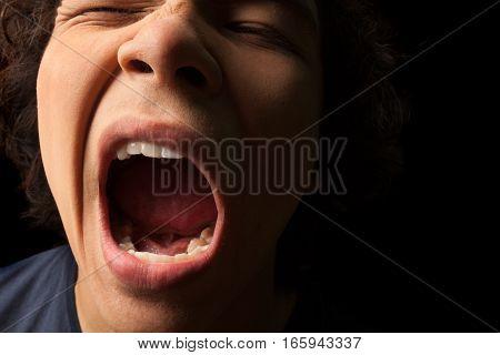 Closeup on a Young Man Yawning / Sleepy