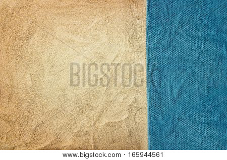 Top view of sandy beach with towel frame. Background with copy space and visible sand texture.