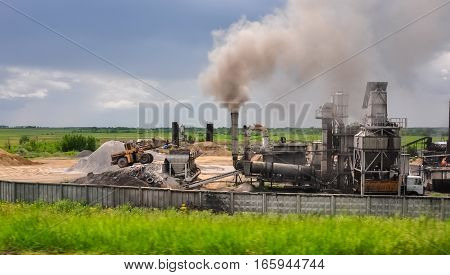 Bulldozer In Industrial Area
