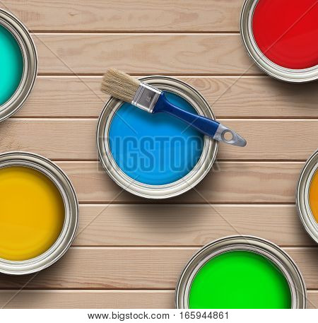 Home improvement colorful paint cans on the clear wooden background with copy space