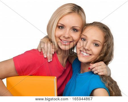 Portrait of Two Smiling Girlfriends / Sisters Holding a Book