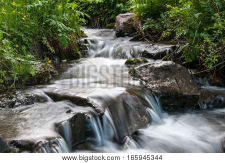 Water stream flowing on the rocks. Altai Siberia Russia