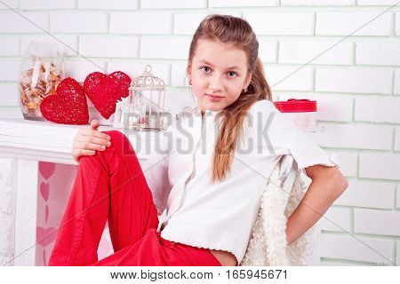 Portrait of young beautiful girl with big eyes near the valentines decorations