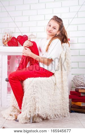 Portrait of young beautiful girl near the valentines decorations