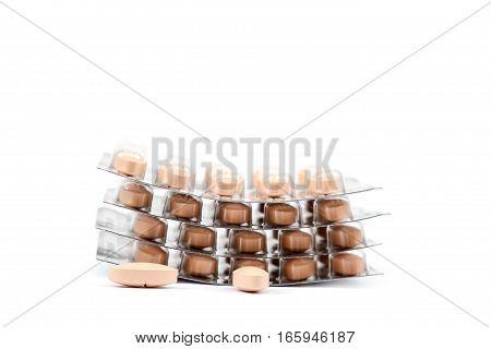 Pills in blister packs isolated on white background.