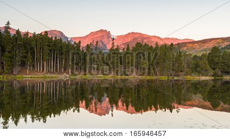 Hallett Peak reflection in Sprague Lake at dawn, in Rocky Mountain National Park, near Estes Park, Colorado.