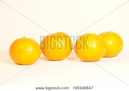 Ripe orange mandarins isolated on white background
