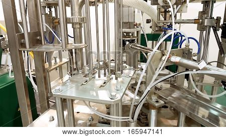 Tanks and containers connected with tubes pipes and valves. Laboratory at food brewing production factory plant. Chemical research tests are important in any production process.