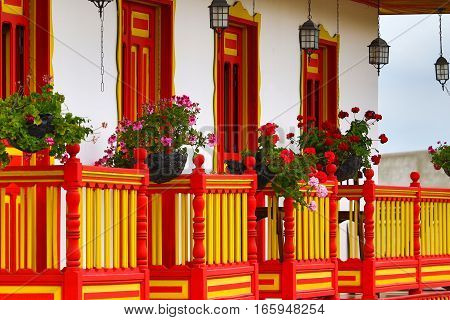September 23, 2016 Salento, Colombia: colonial style wooden balconies decorated with blooming flowers in the centre of the coffee producing small town