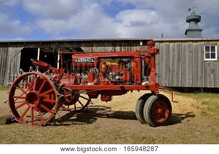 ROLLAG, MN, Sept 1, 2016: Farmall tractor F-12 is displayed at the West Central Steam Threshers Reunion(WCSTR) where 1000s attend each Labor Day weekend in Rollag, MN each year.