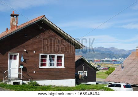 Traditional house and view to the city and mountains in Ushuaia